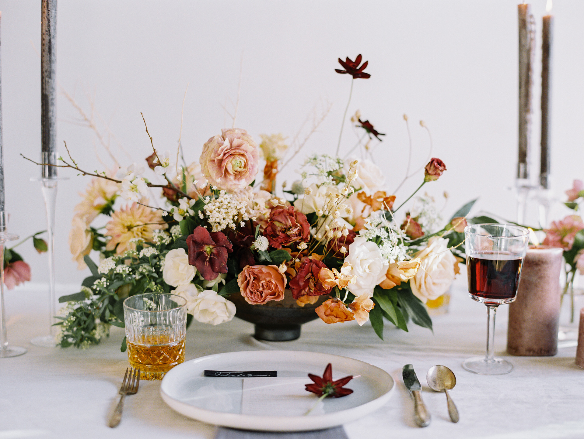 Chocolate cosmos, lisianthus, ranunculucs and dahlias in shades of nude, copper, and burnt sienna. Photo: Gaby Jeter