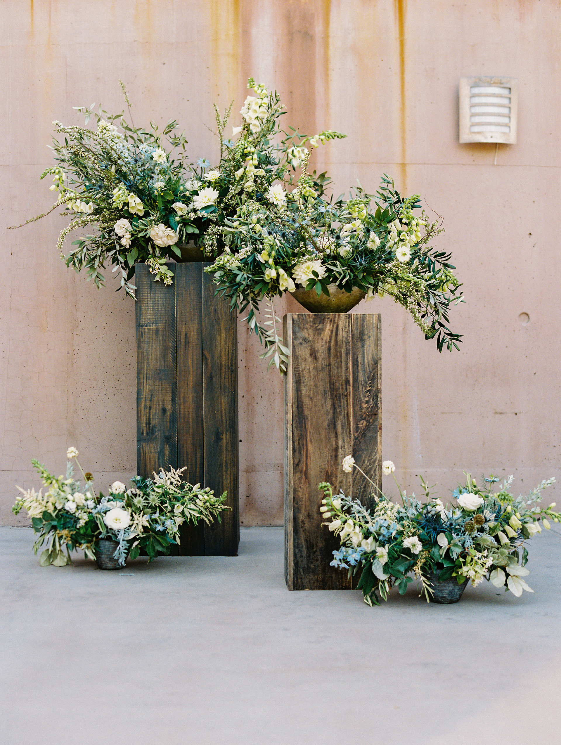 Organic floral arrangements with thistle, foxglove, nigellia, astilbe, delphinium, and olive. Photo: Gaby Jeter