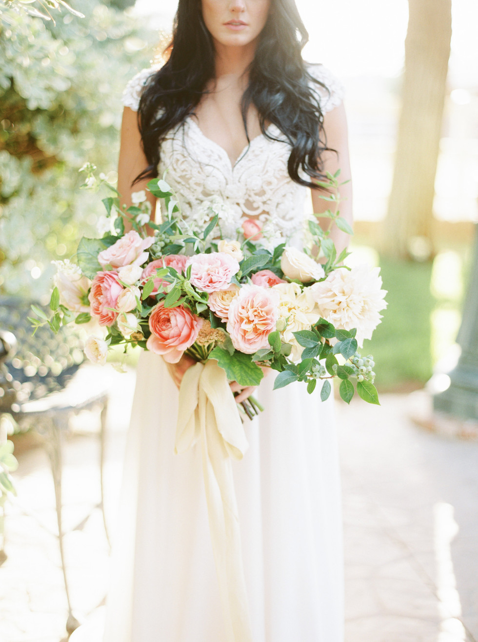 Garden-style summer bridal bouquet with Romantic Antique and Augusta Louise garden roses, honeysuckle and blueberries. Photo: Elyse Alexandria