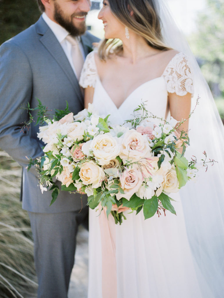 DUSTY BLUSH AND IVORY BOUQUET, TIED WITH SILK RIBBONS. PHOTO: LIANNA MARIE