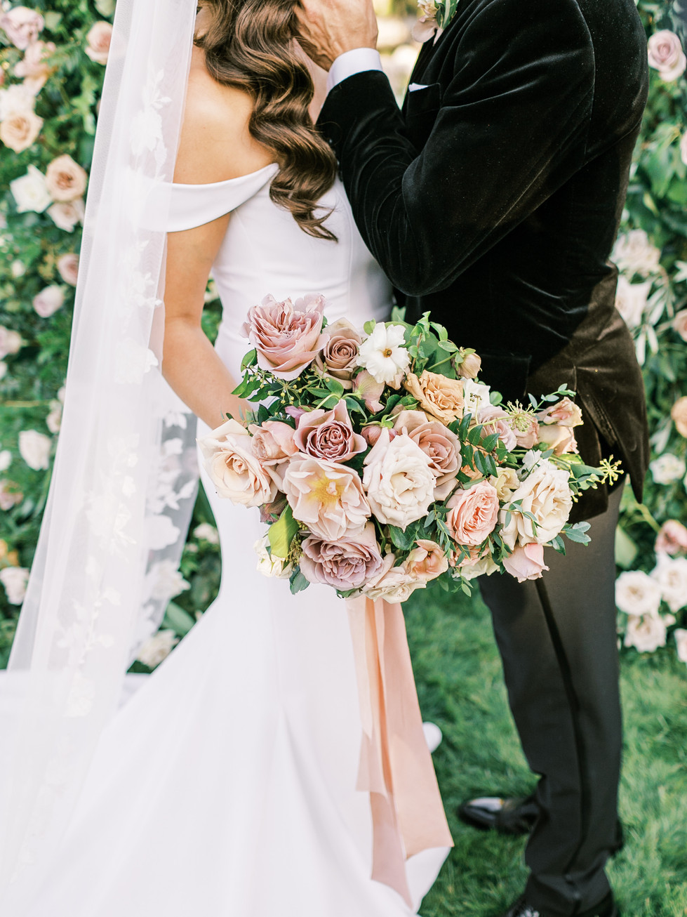Dusty rose, blush, and toffee colored bridal bouquet, with treailing silk ribbons. Photo: Lianna Marie
