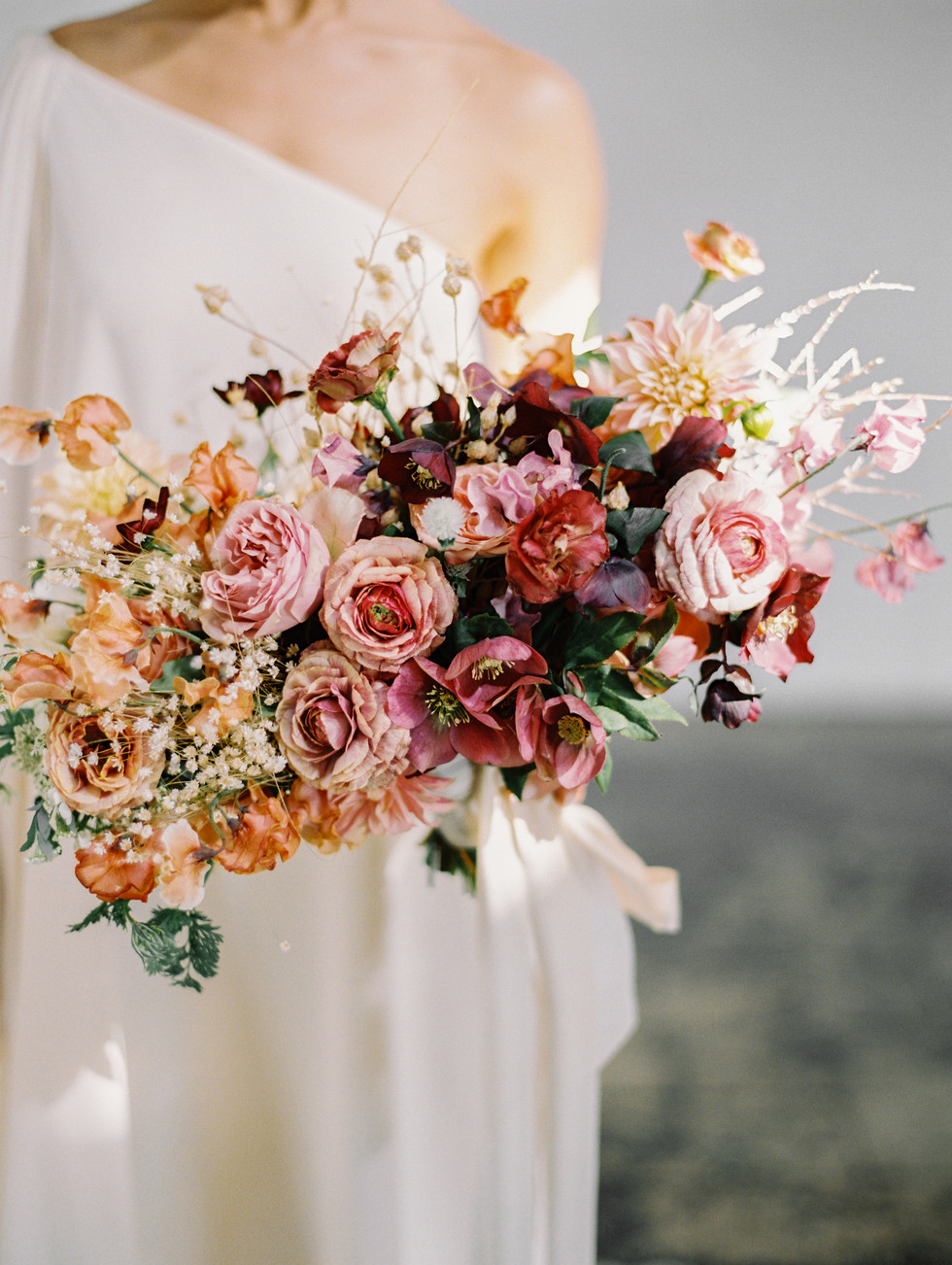OMBRÉ BRIDAL BOUQUET WITH HELLEBORES, RANUNCULUS, SWEET PEA, AND DRIED FLORAL. PHOTO: GABY JETER