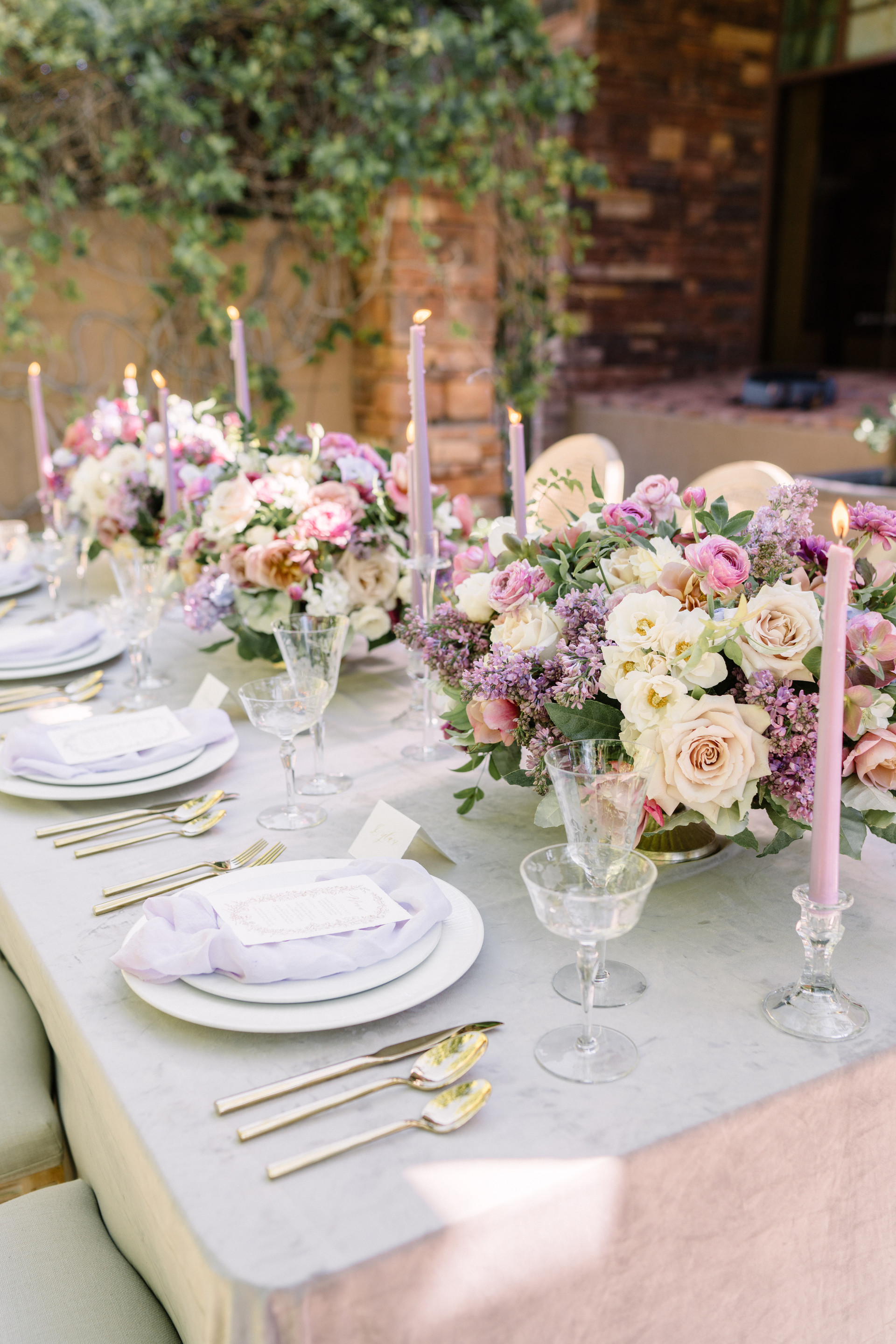 Lavender, plum, chocolate and dusty pink wedding centerpieces. Photo: Gaby Jeter