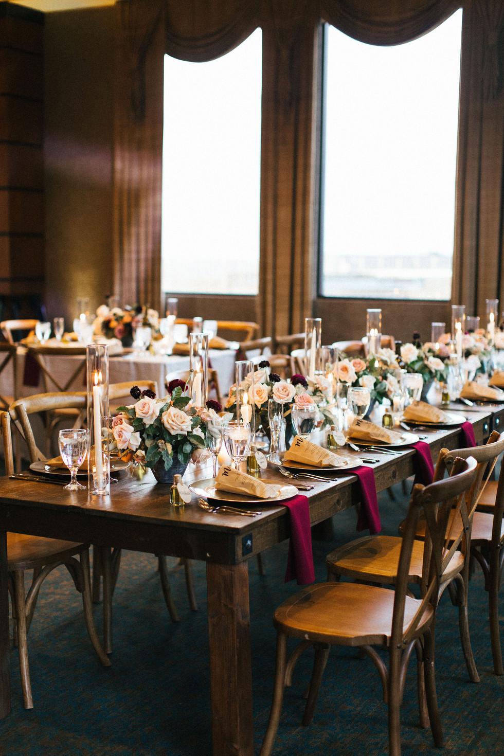 Burgundy, mauve, and dusty blush wedding centerpieces. Photo: Shannon Elizabeth