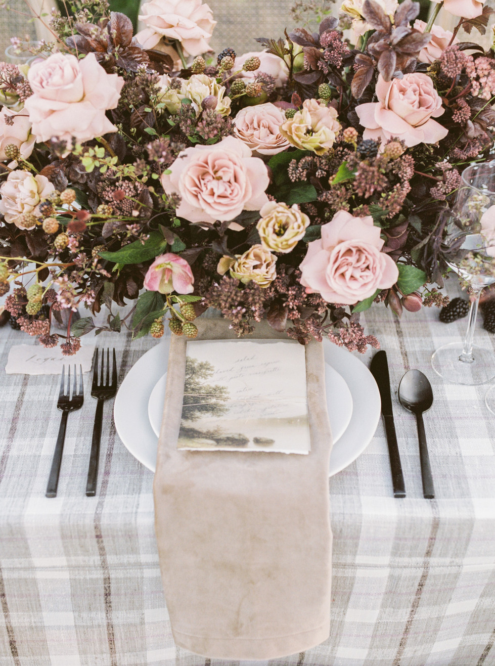 Centerpiece with Cappuccino roses, hellebore, lisianthus, black berries, and plum foliage. Photo: Lianna Marie