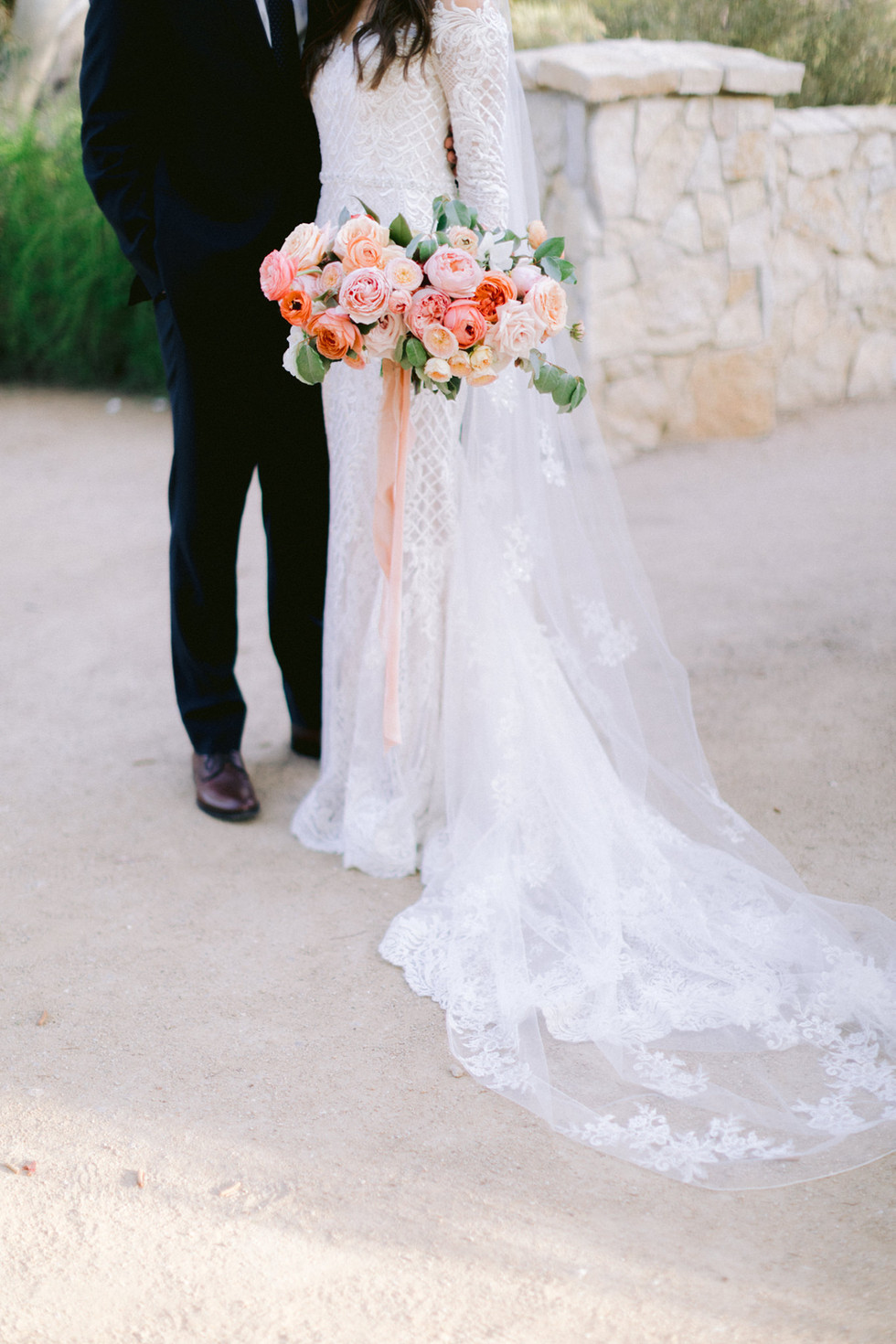 Coral, peach, and blush bridal bouquet. Photo: Susie and Will