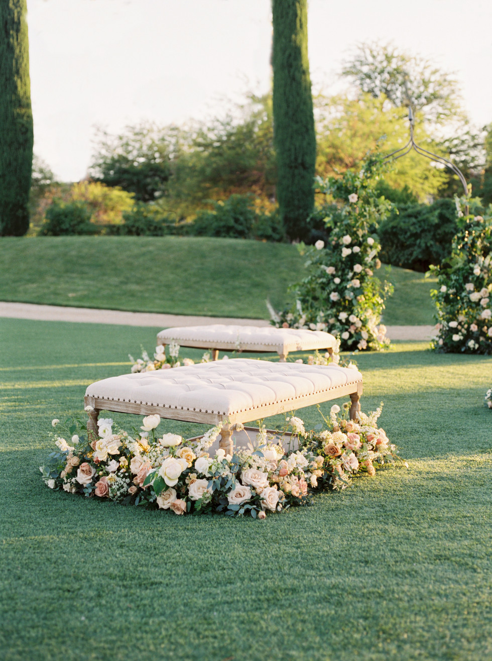 Lush florals for ceremony seating. Photo: Lianna Marie