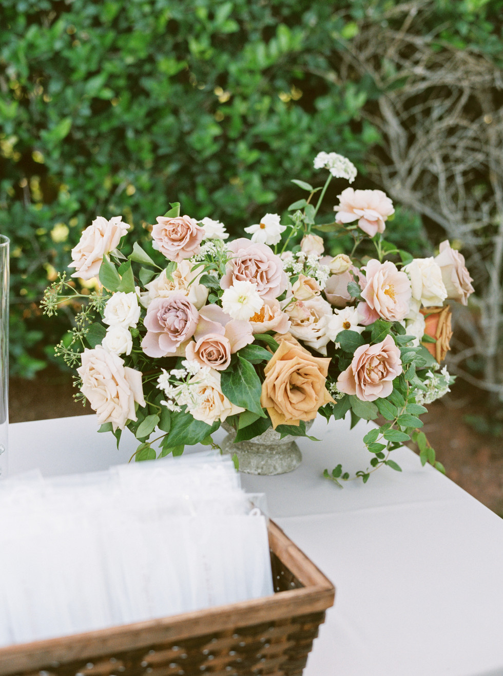 Dusty rose and toffee floral arrangement for Welcome Table. Photo: Lianna Marie
