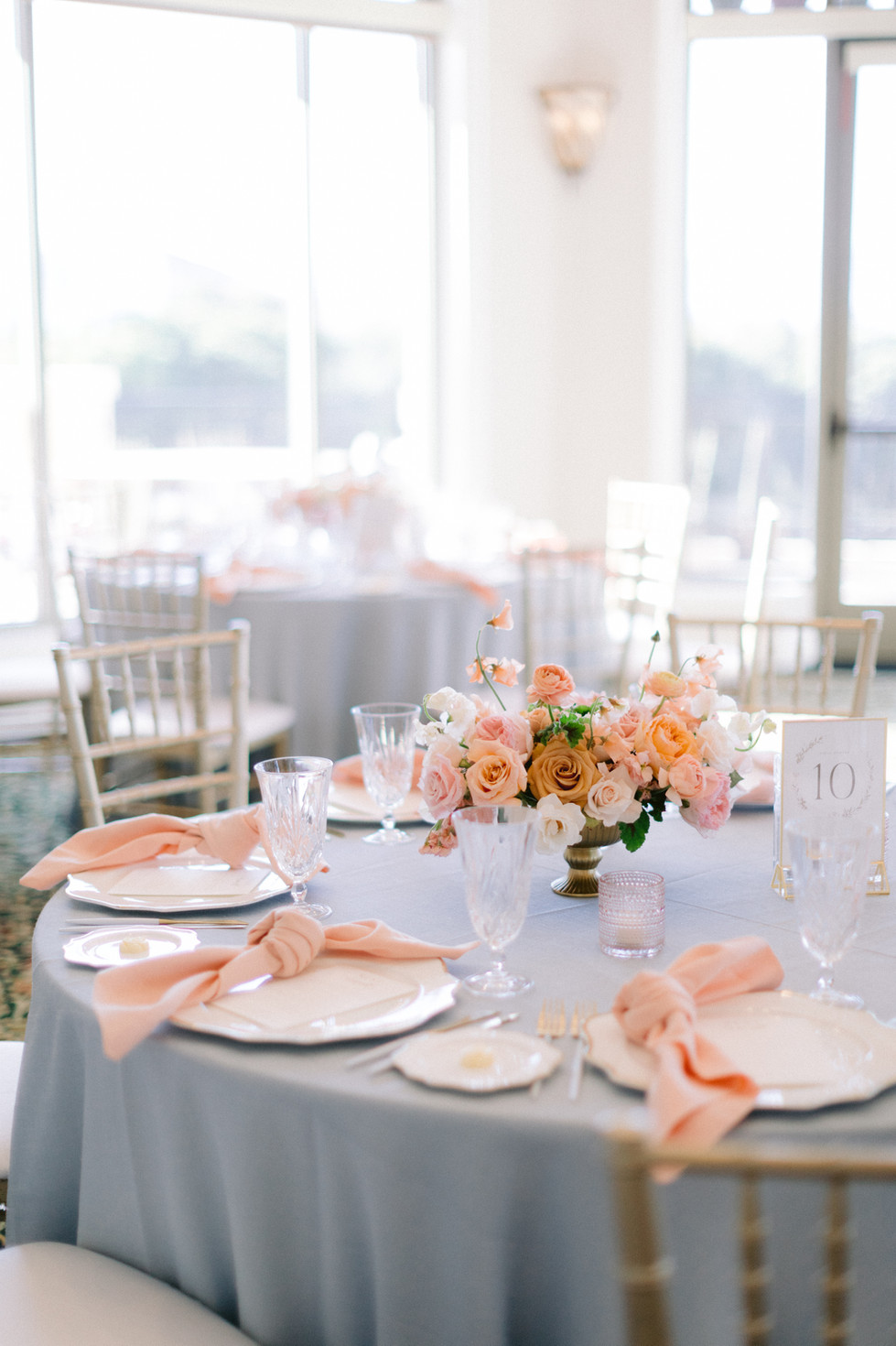 Peach and gold wedding centerpiece. Photo: Susie and Will