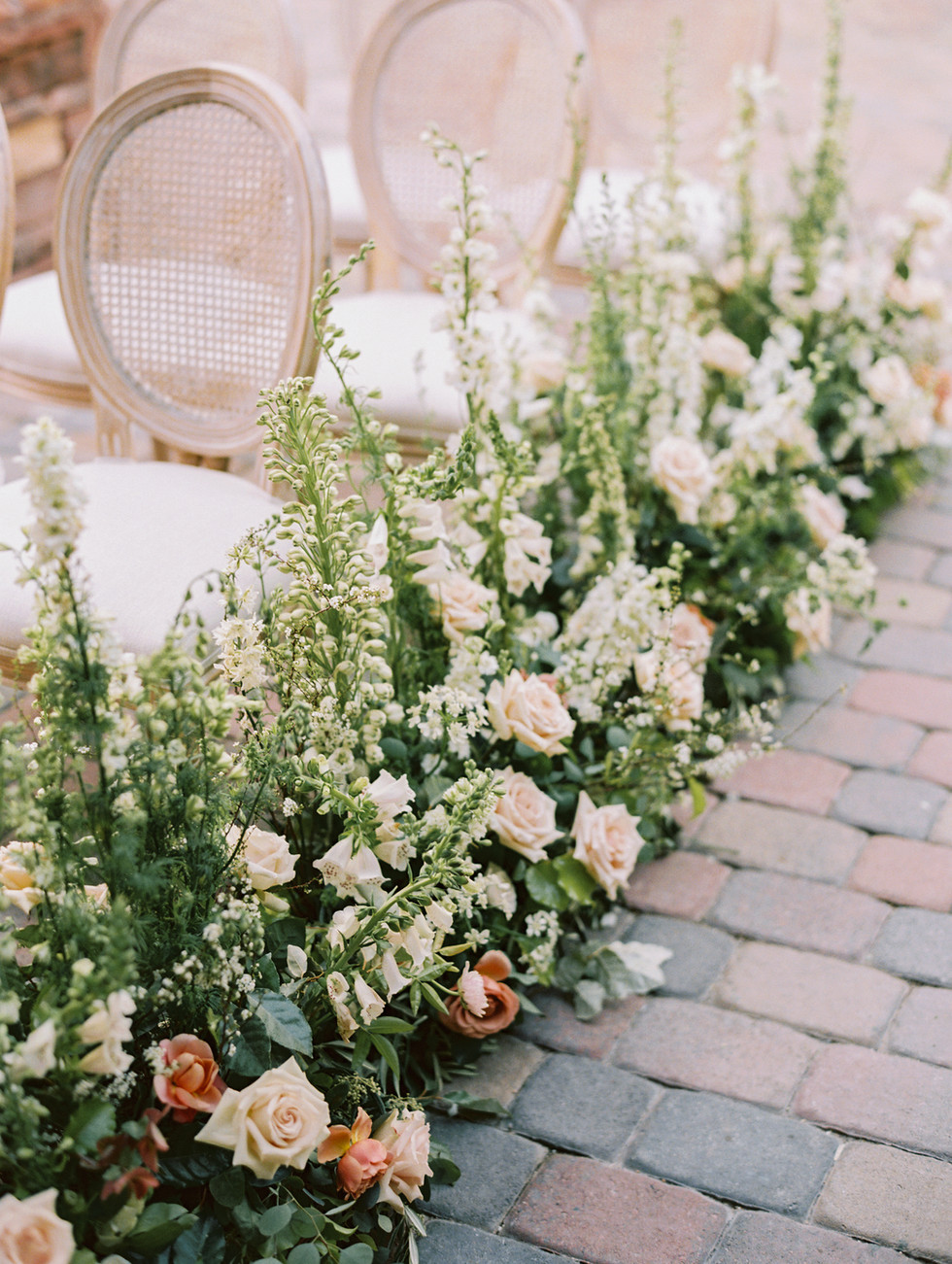 Aisle floral with garden roses, foxglove, and delphinium. Photo: Gaby Jeter