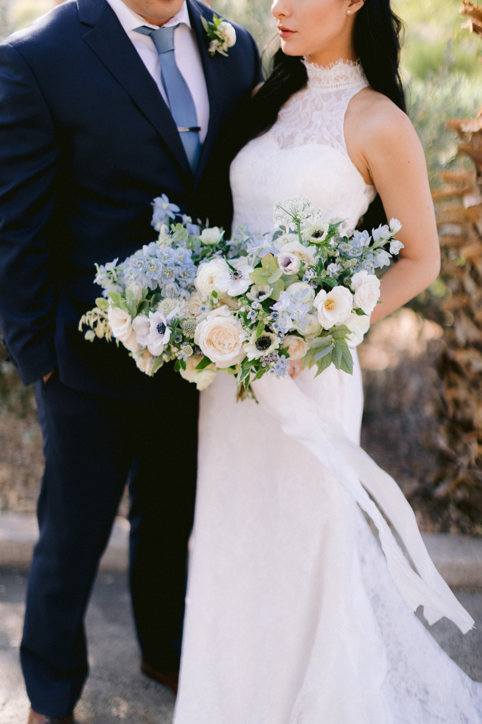 Dusty blue and ivory wedding bouquet with garden roses, anemones, tweedia, and delphinium. Photo: Susie and Will
