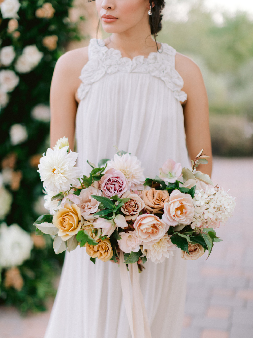Dusty rose and taupe bridal bouquet, wrapped with silk ribbons. Photo: Susie and Will