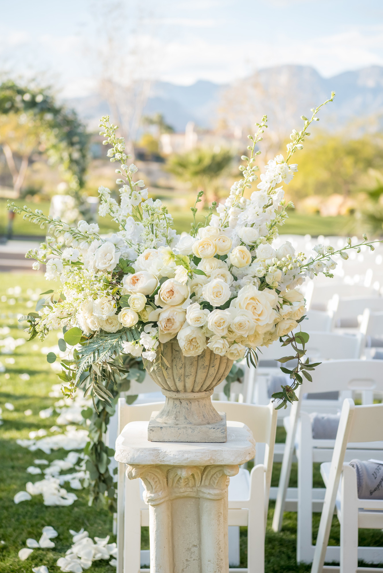 Ceremony Aisle arragnements with garden roses, peonies, and delphinium. Photo: KMH Photography