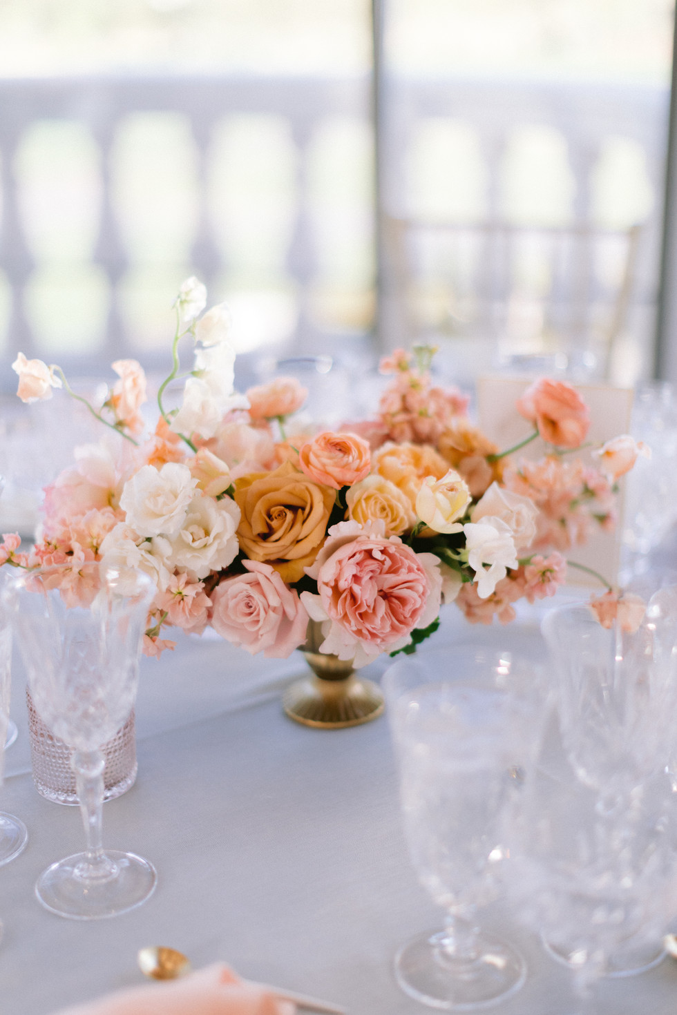 Peach, pink, and gold wedding centerpiece. Photo: Susie and Will