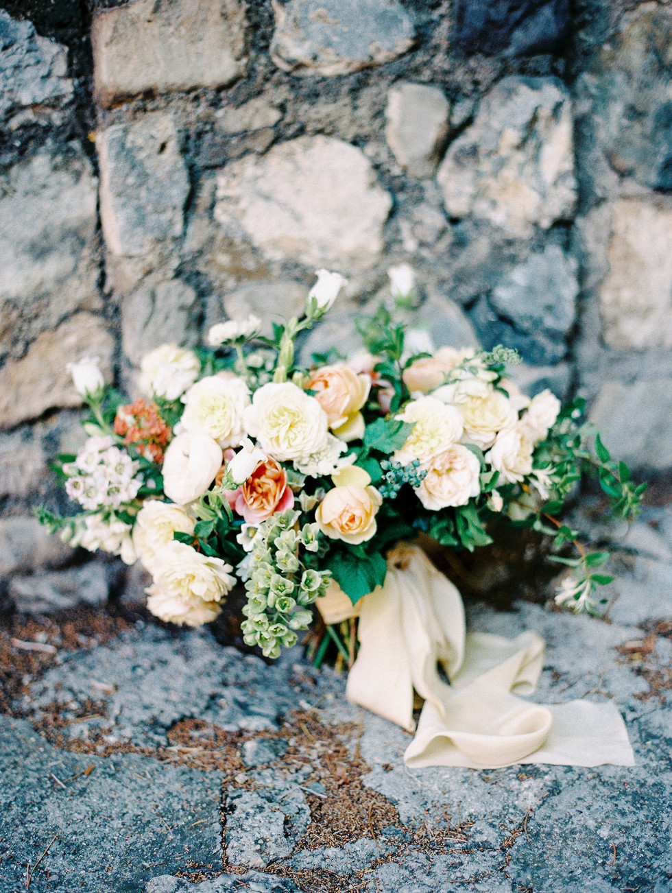 Lush, garden-inspired bridal bouquet with garden roses, fritillaria and honeysuckle. Photo: Shannon Elizabeth
