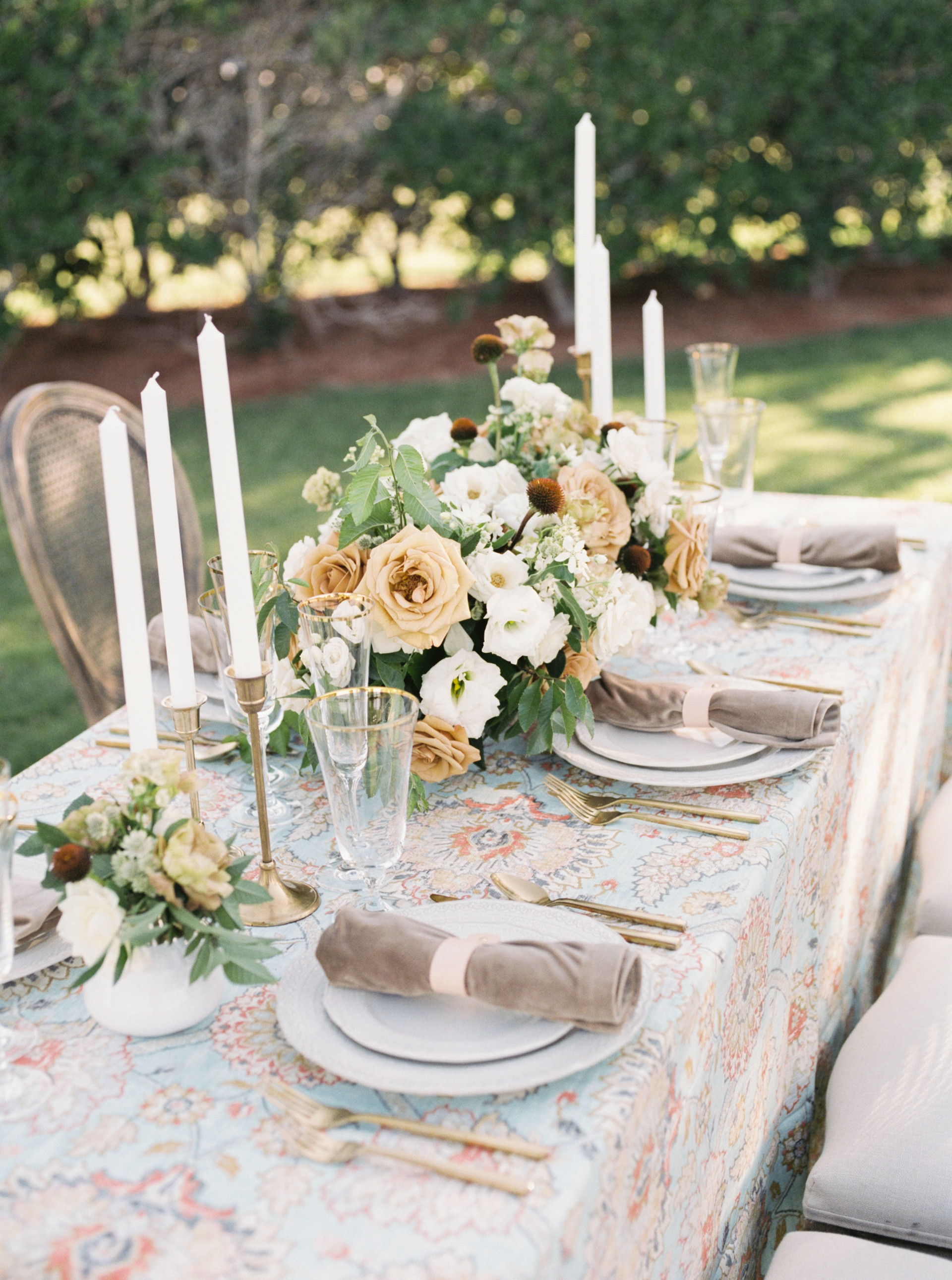Whimsical summer tabletop details in shades of mustard and ivory. Photo: Lianna Marie