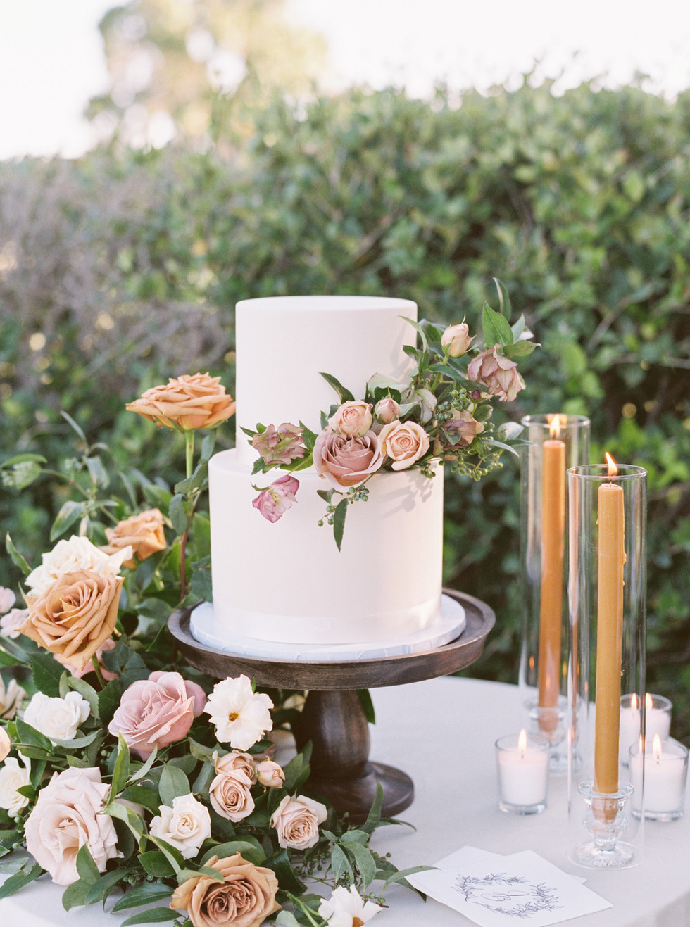 Toffee and dusty rose floral arrangement and cake floral with toffee colored taper candles. Photo: Lianna Marie