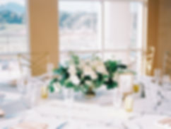 White Centerpiece in Gold Compote Vase