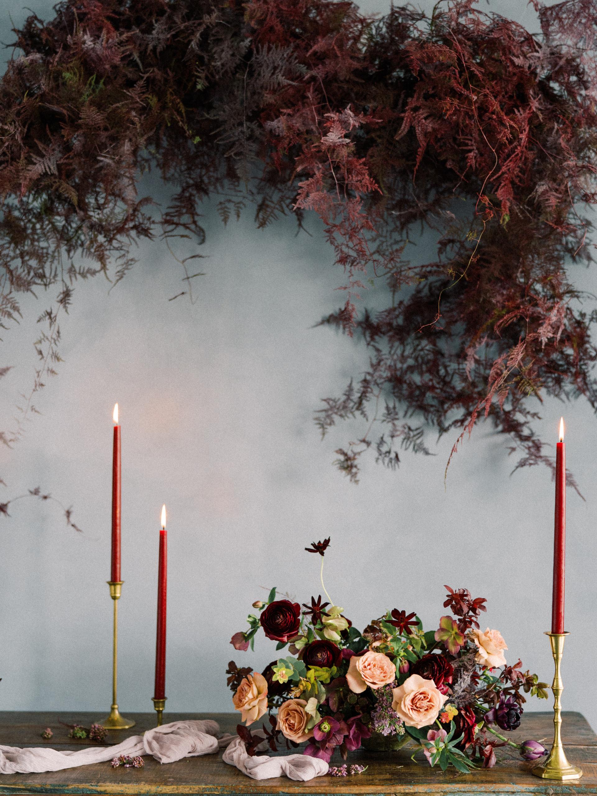 Marsala, plum, and blush floral centerpiece. Photo: Gaby Jeter