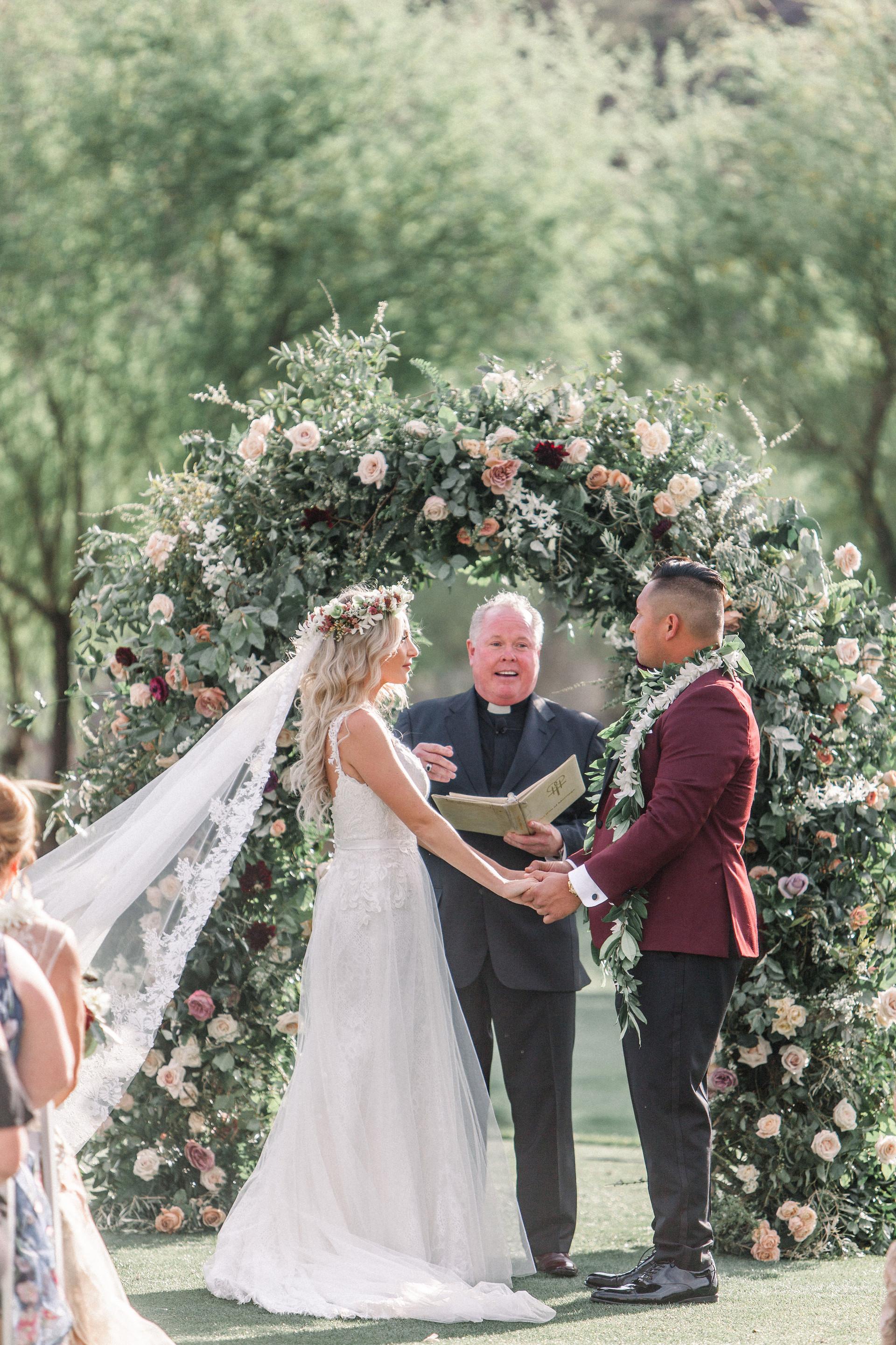 Marsala and blush wedding arch. Photo: Shannon Elizabeth
