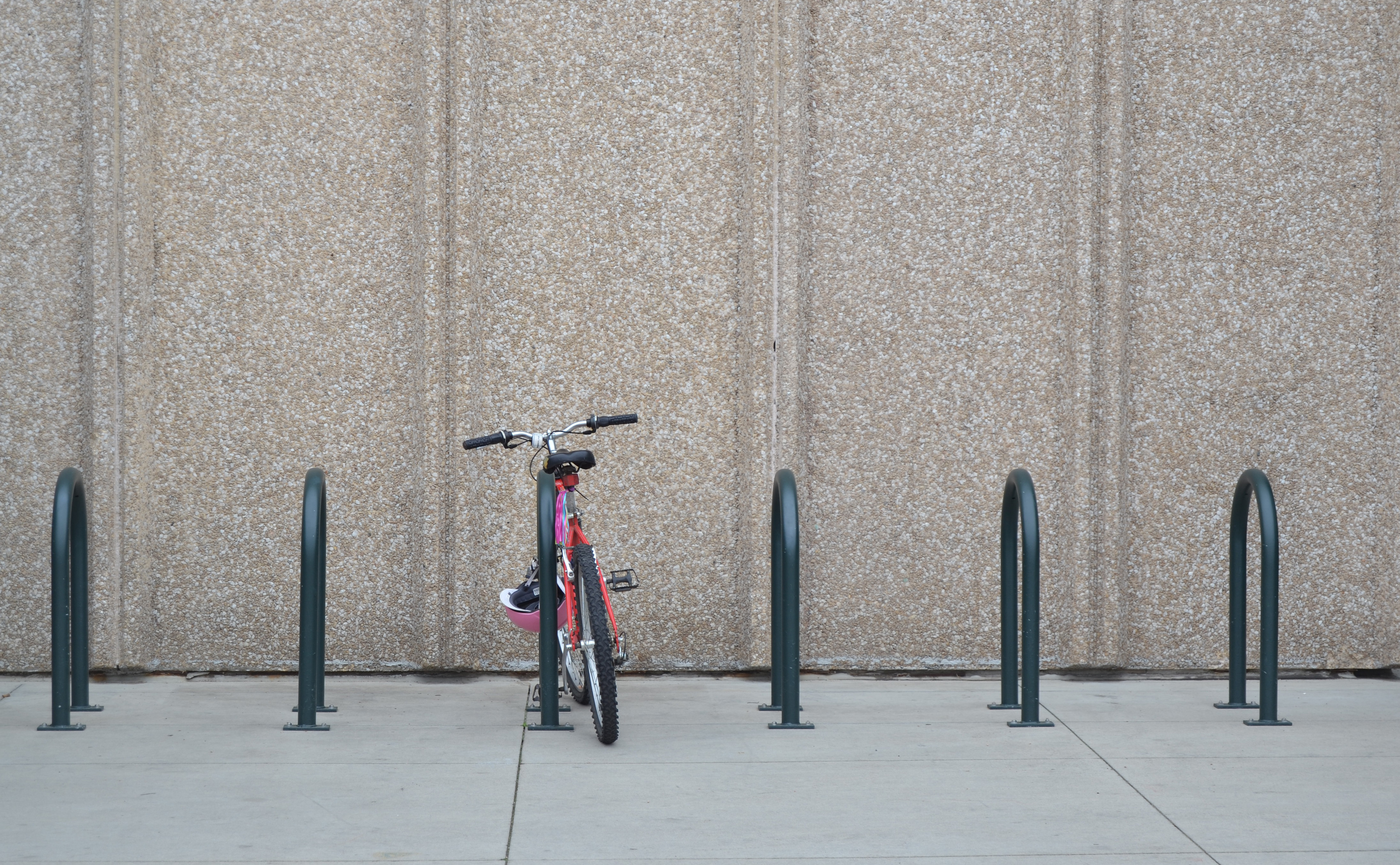 Bike rack in front of concrete wall