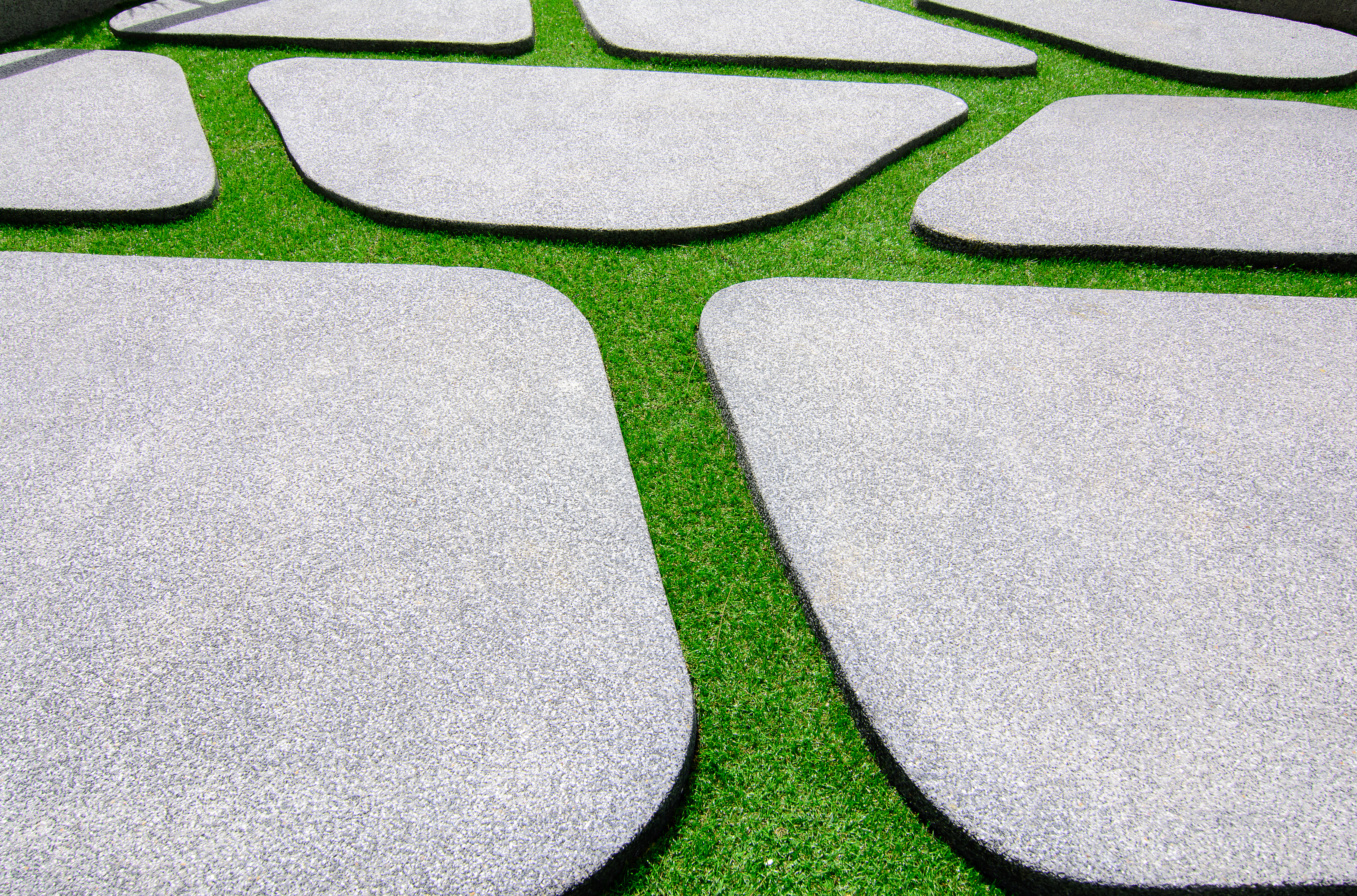 Green artificial grass with  stone of sand flooring block texture or Sand wash background