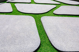 Green artificial grass with  stone of sand flooring block texture or Sand wash background.jpg