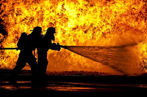 firefighters-spraying-water-over-fire