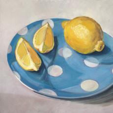 Lemon on blue spot plate