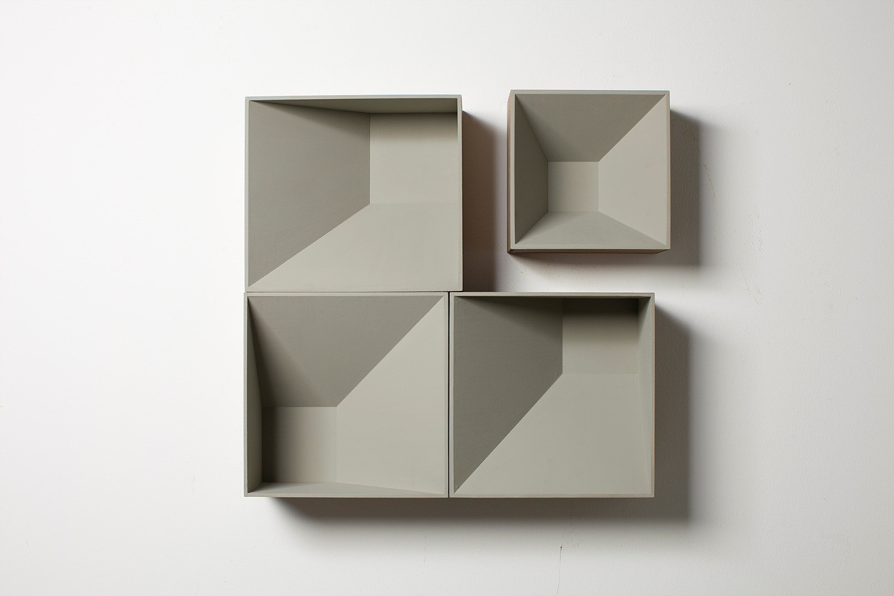 Four grey boxes, 2013, wall paint, wood stain on MDF, 65 x 66 x 16 cm
