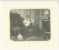 African American youth playing banjo