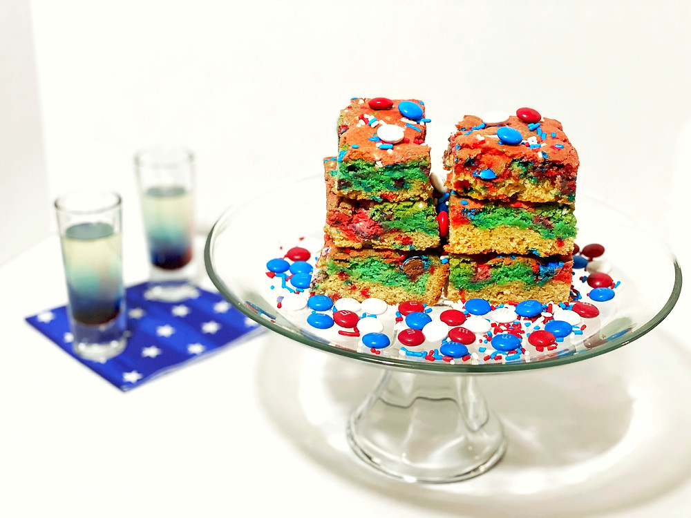 red, white and blue blondies with m&m's and astro pop shots. patriotic dessert