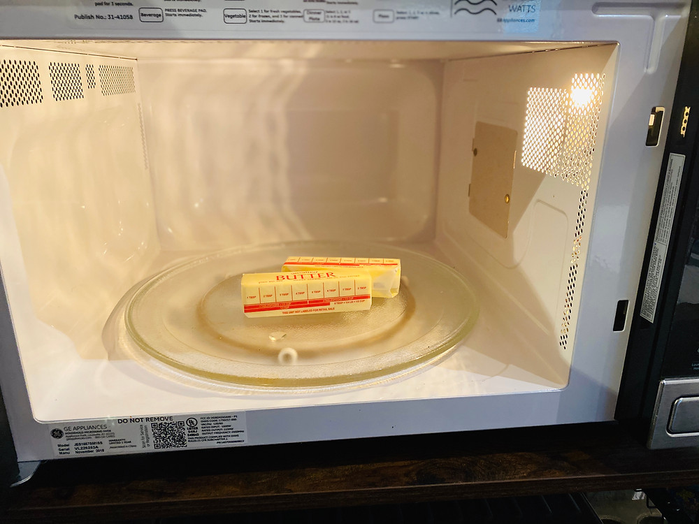 unsalted butter resting in the microwave