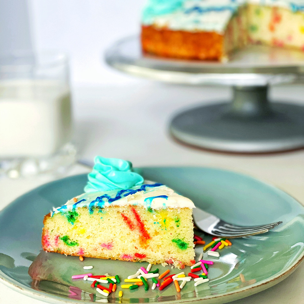 Funfetti sprinkle cake with blue, vanilla buttercream frosting