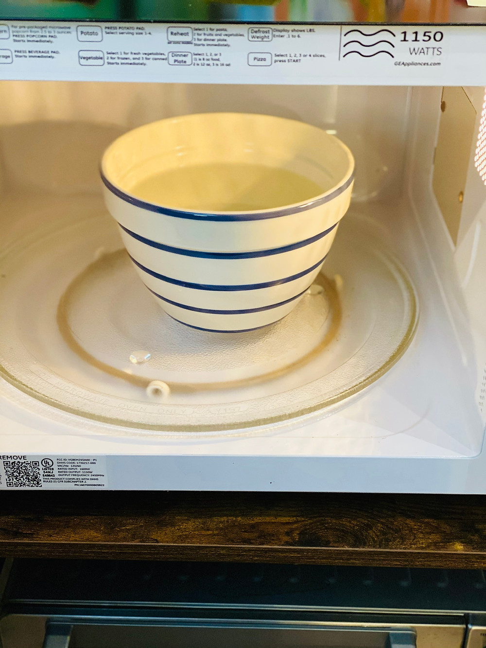 water heating up in a bowl in the microwave
