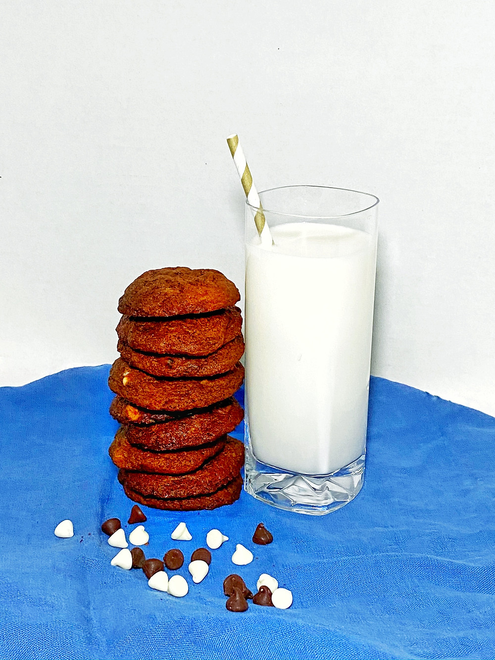 Chocolate chocolate chip cookies with a glass of milk