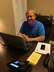 Jim Cochran at desk