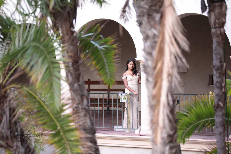 Lady champange Prom dress inbetween trees at the Prada  in Balboa downtown San Diego Ca Ridgecrest Countryboiphotography.com