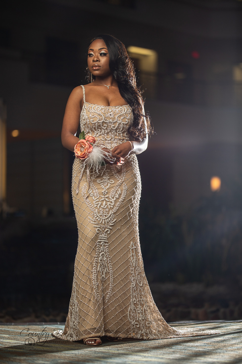 African american young woman in fancy cream Prom dress in Hiltion hotel Gaslamp San Diego CA Ridgecrest Countryboiphotography.com