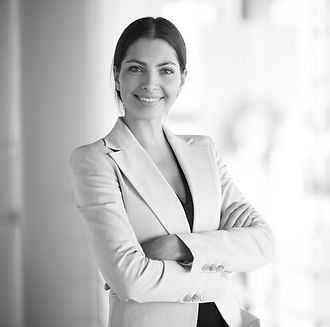 smiling-female-business-leader-with-arms
