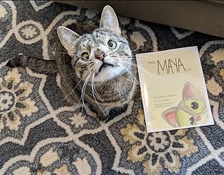 Maya beside her book