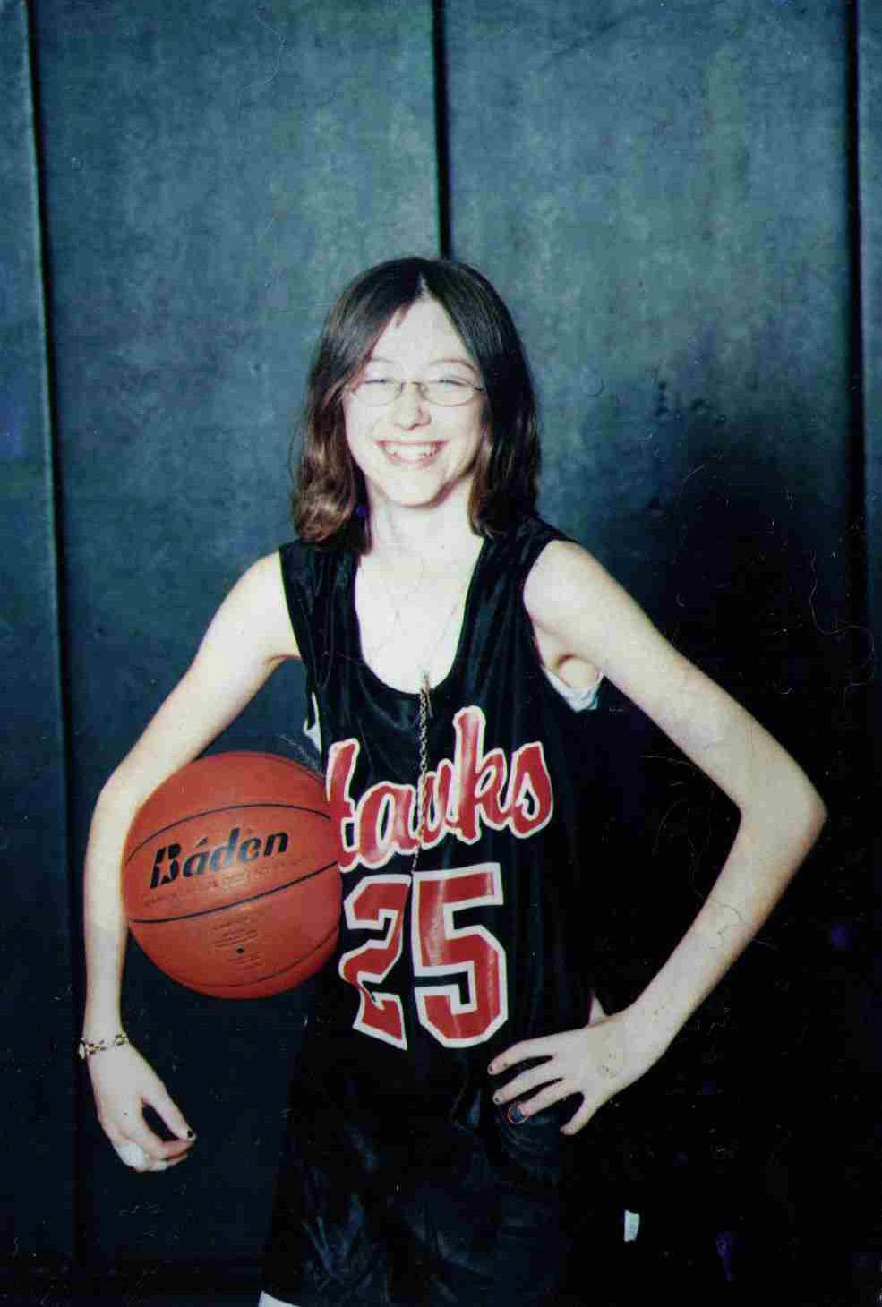A photo of me from my youth, holding a basketball. My arms are extremely thin.