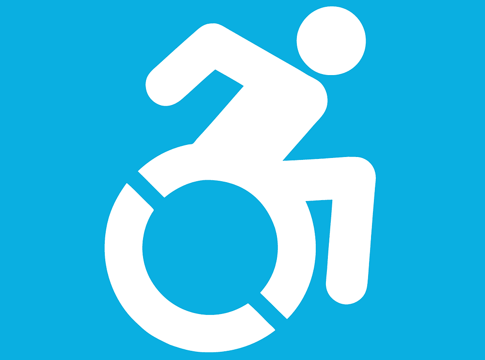 The iconic symbol for disability, showing a person leaning forward in their wheelchair to transport themselves. Classic stick person style.
