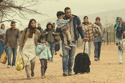 ey-family-refugees-travels-desert.jpg