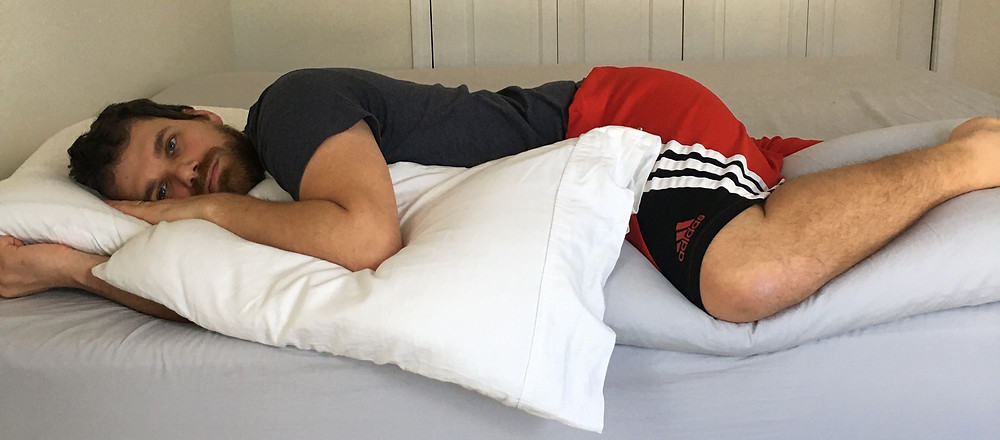 Half belly half side supported sleep with pillows and towels.