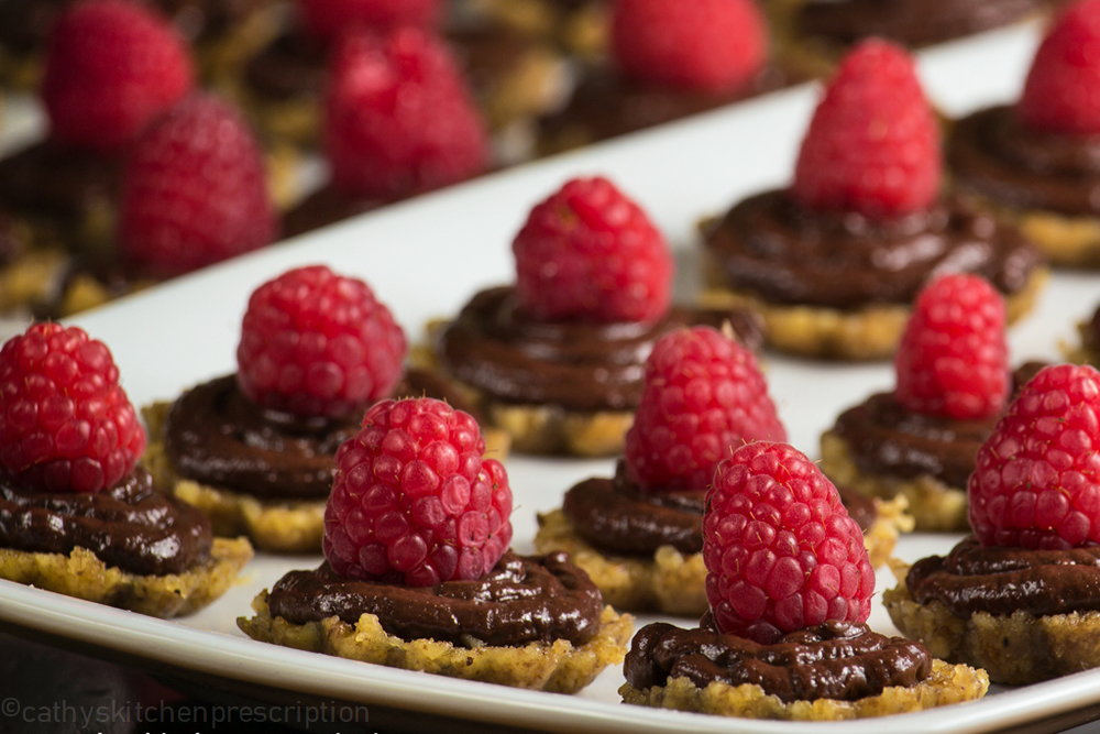Ganache and Raspberry Tartlets