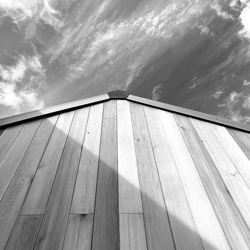 Cedar Timber Cladding Apex Building Against a Clear Sky