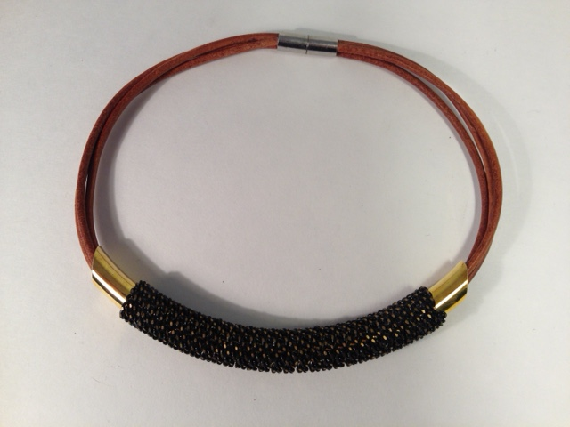 Massai Mara necklace. Gold/blk chain on tan leather