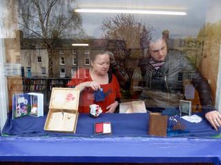 Arranging display in Hay Cinema Bookshop
