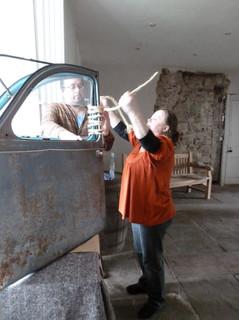 Ellie Garraway installing artwork in Hay Castle